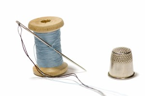 500267-spool-of-thread-with-needle